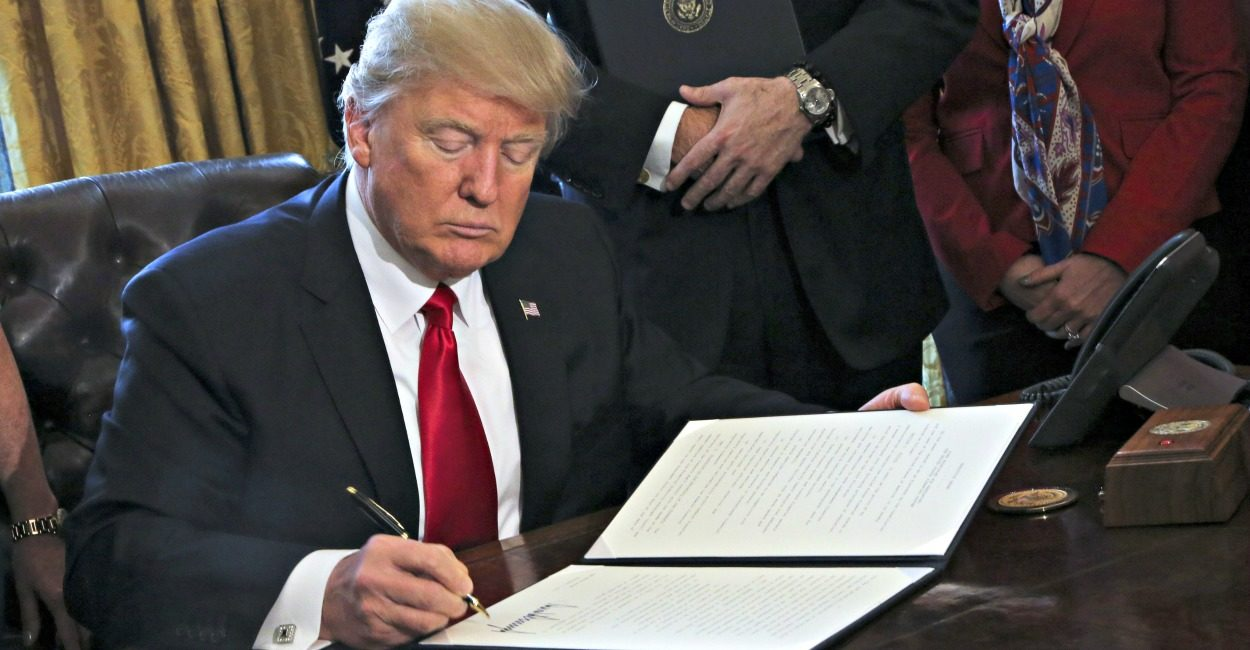 Donald ZTrump singing an executive order
