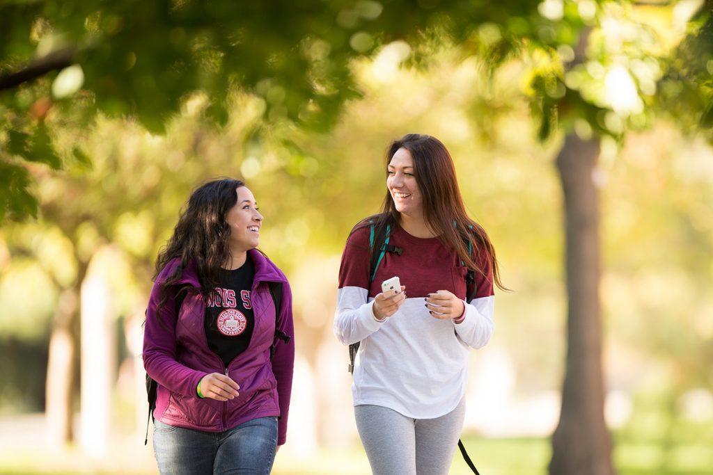 Illinois State students walk on the Quad