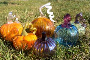 glass pumpkins from ISU Glasshouse, sitting on the grass