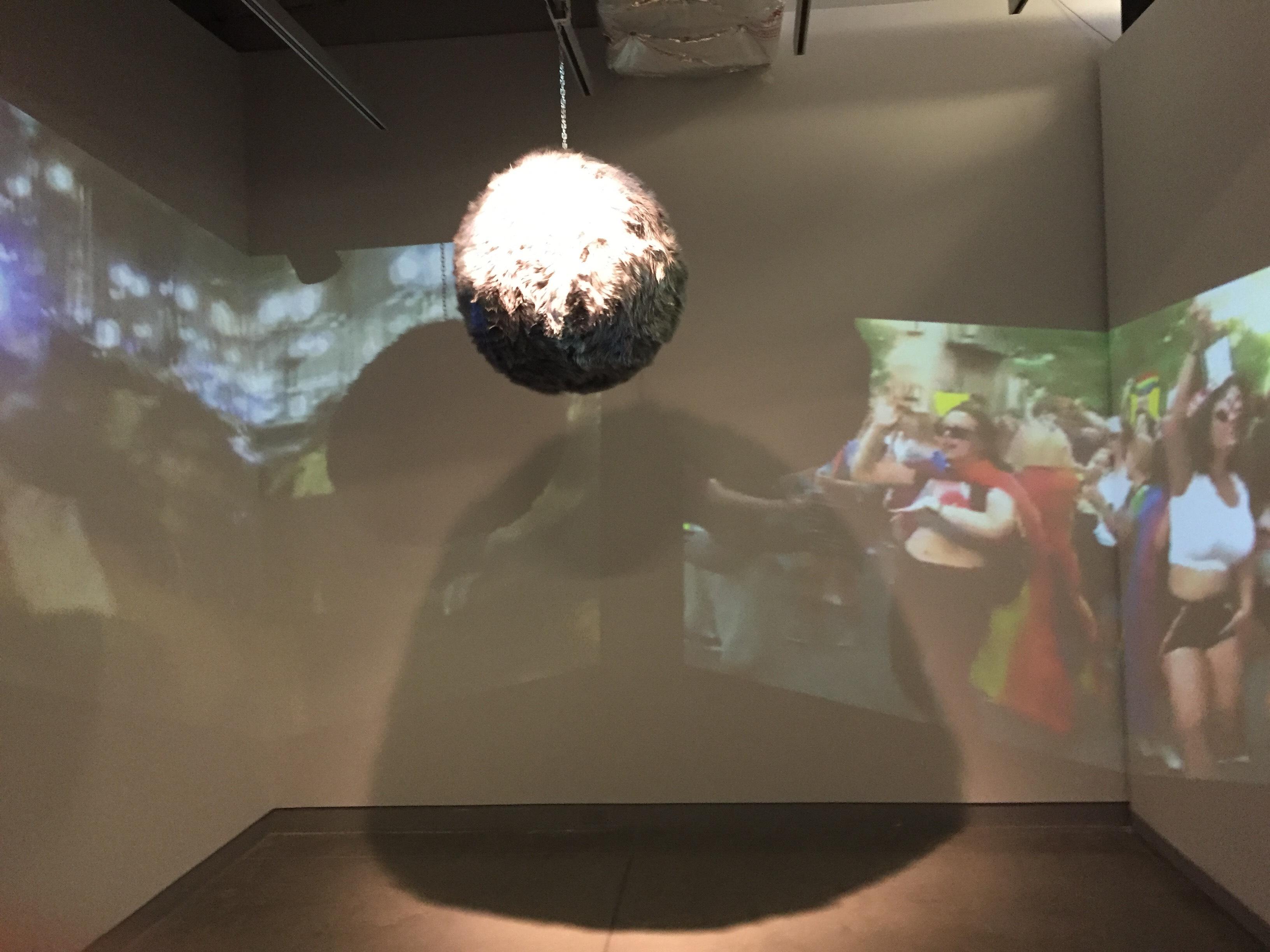 video of people dancing under glowing disco ball