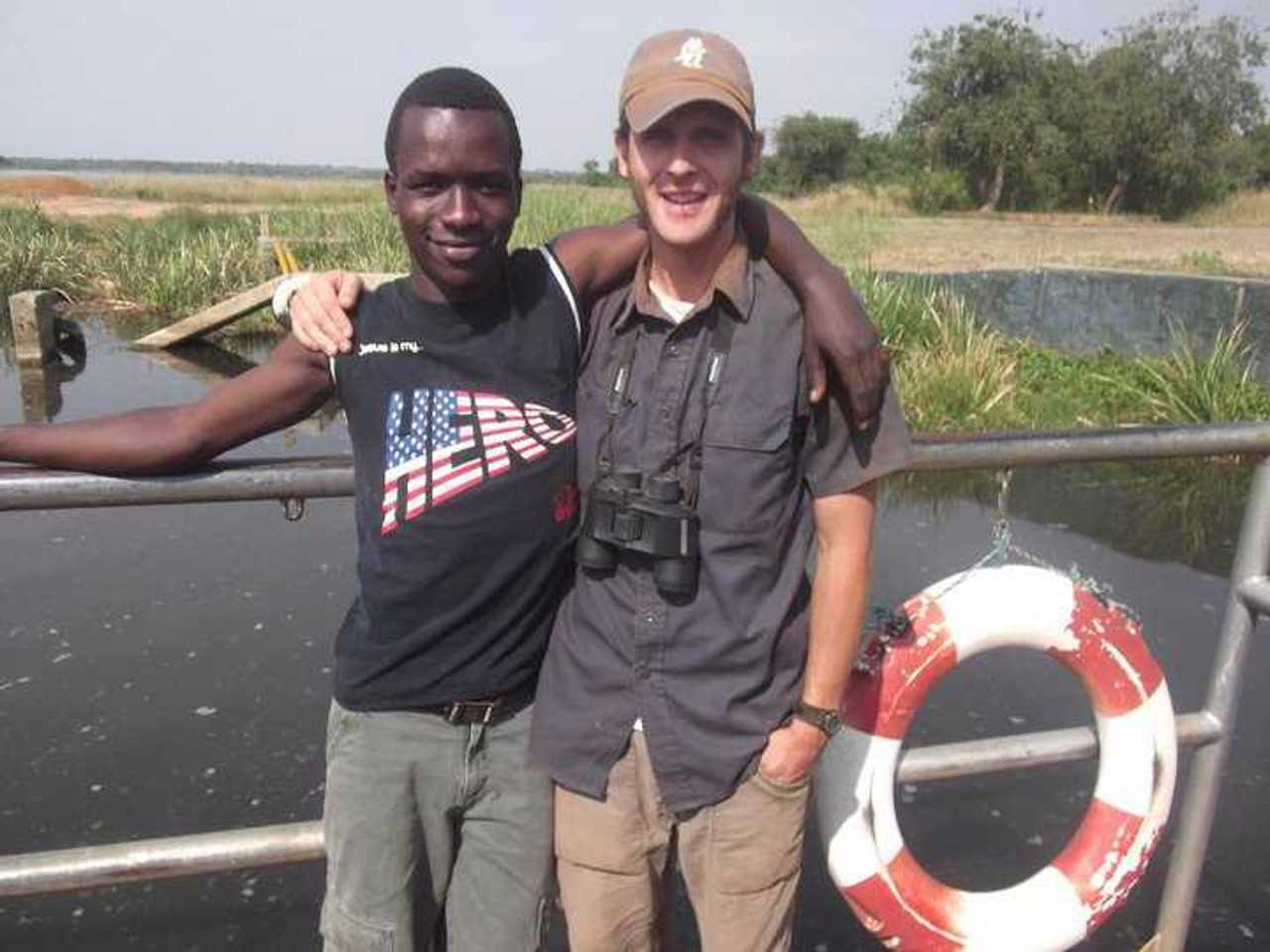 Doug Gass with a friend on a boat on the Nile River.