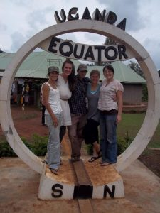 Doug Gass with friends at the equator in Uganda.