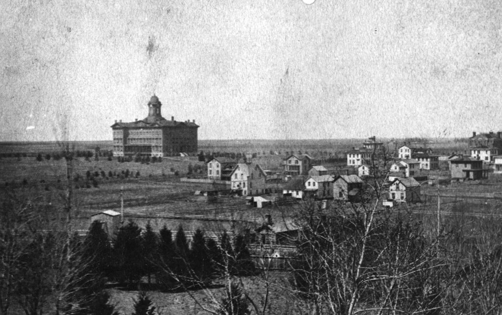 painting of Old Main surrounded by smaller houses