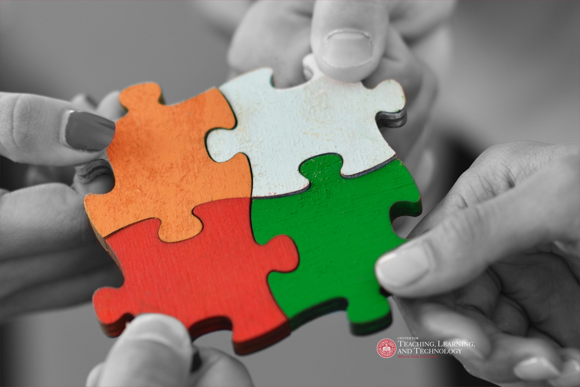 Hands holding puzzle pieces