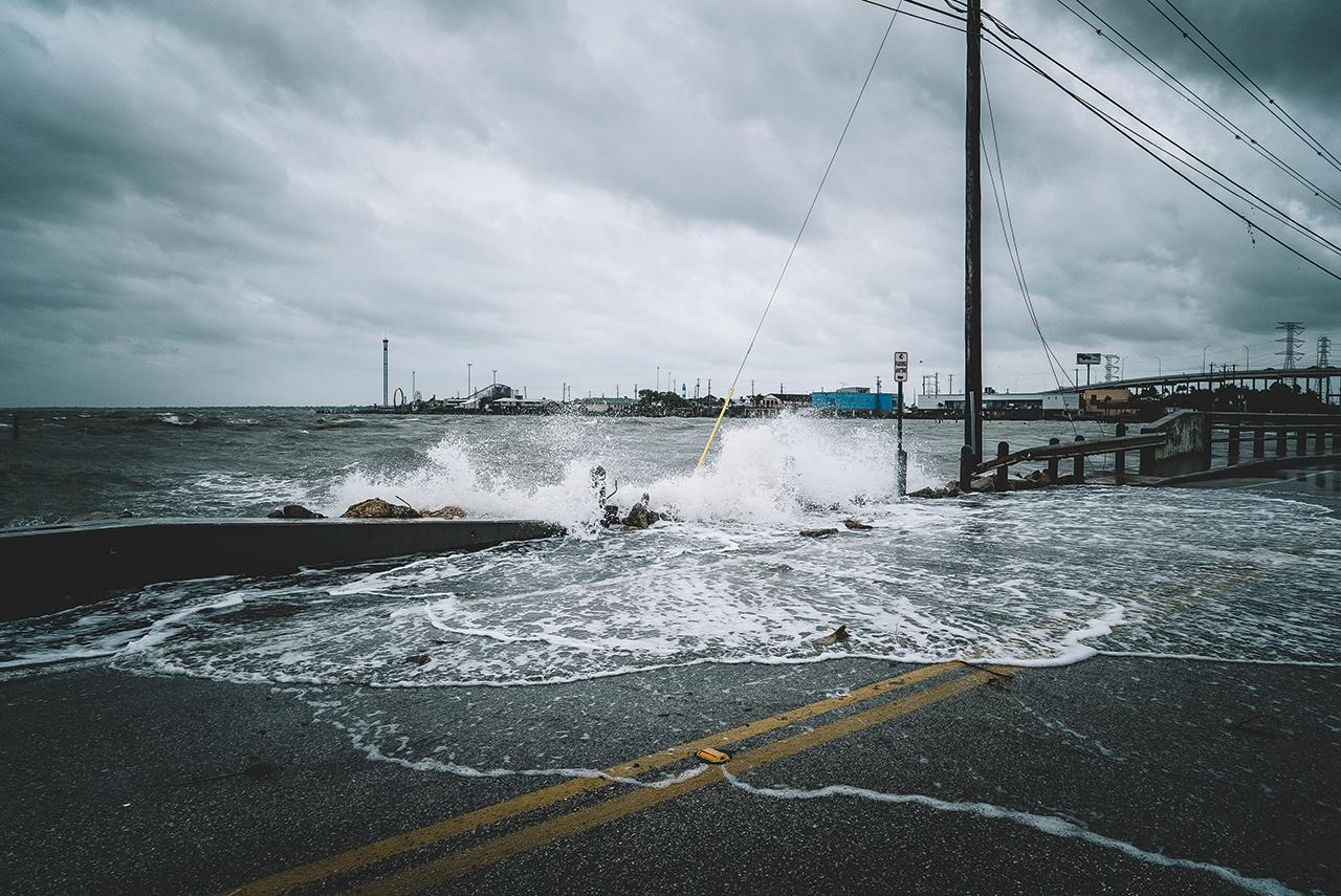 Water crashing over a bridge during Hurricane Harvey in Kemah, Texas