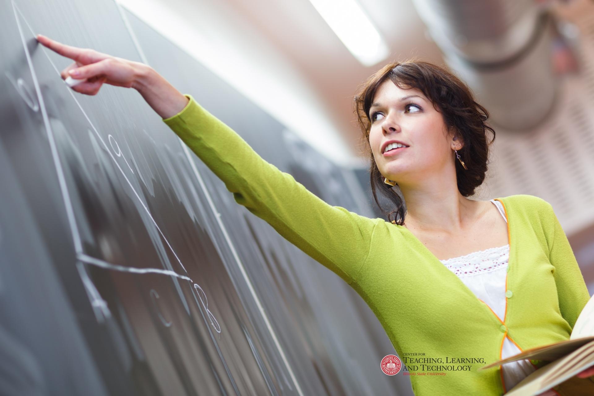 Teacher pointing at chalkboard