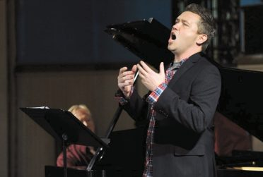 Justin Vickers singing in concert