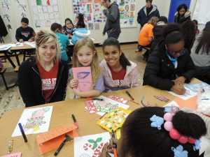 Illinois State University students create gifts with their Holiday Helper children.