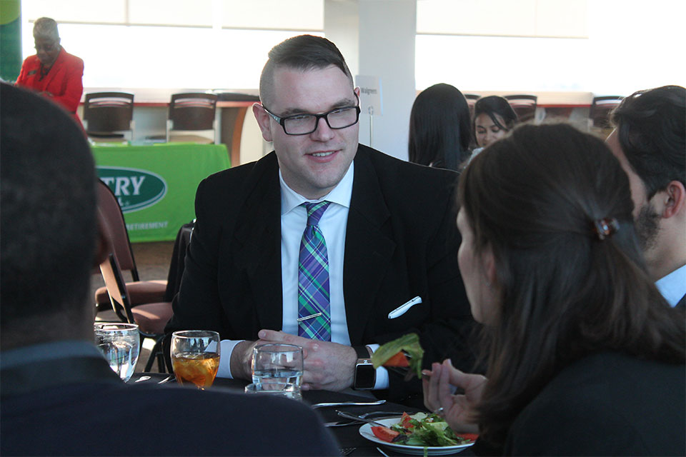 Students happily engage to create networking opportunties.