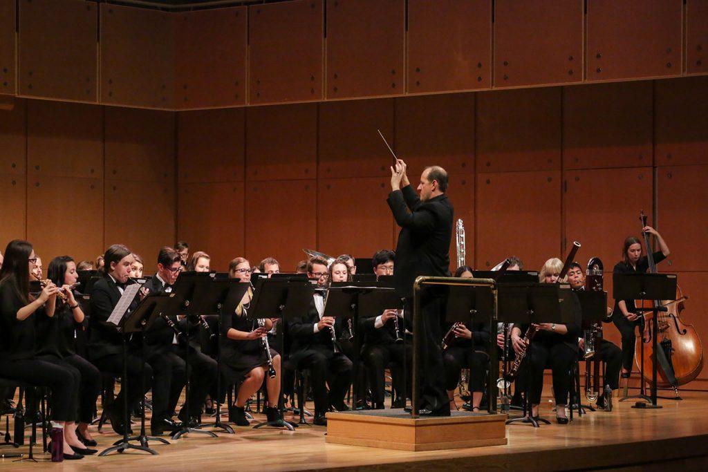 Photo of Anthony Marinello conducting the ISU Wind Ensemble on September 22, 2017