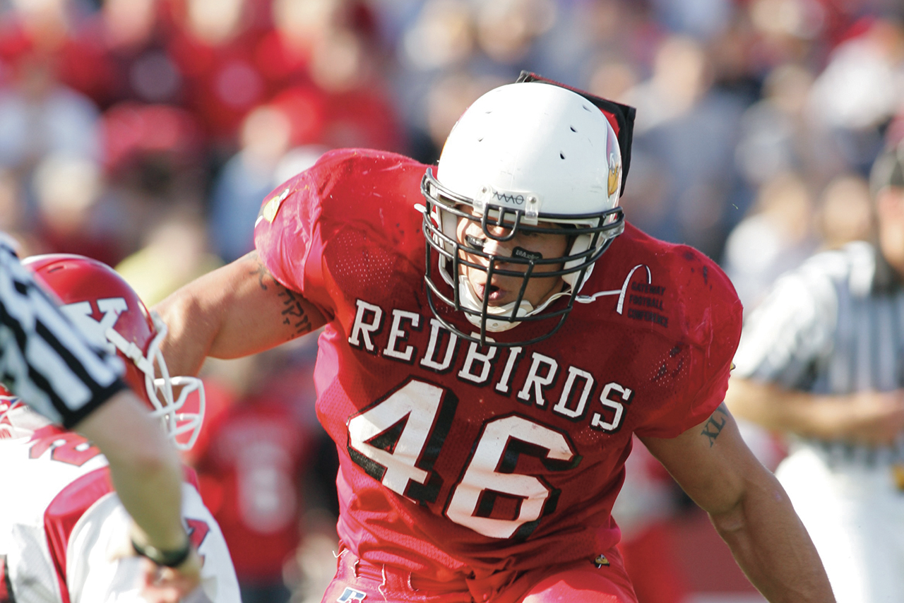 Boomer Grigsby '07 playing football for Redbirds