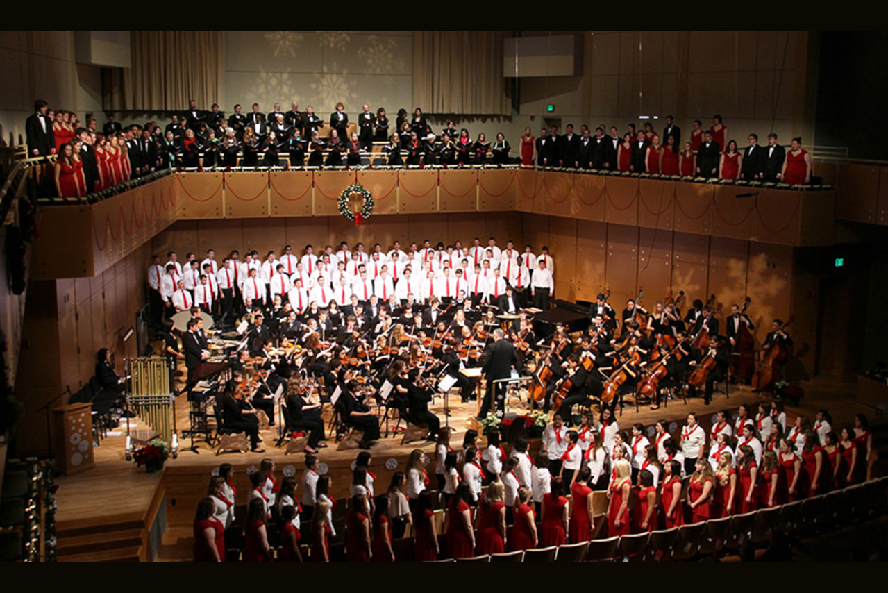 Photo of a previous Music for the Holidays concert with a combined orchestra and choirs on stage.