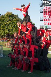 students forming human pyramid