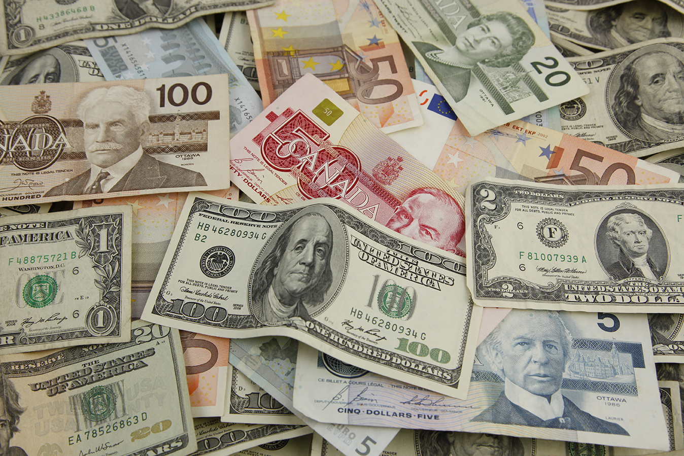 image of international currency, money from countries all over the globe