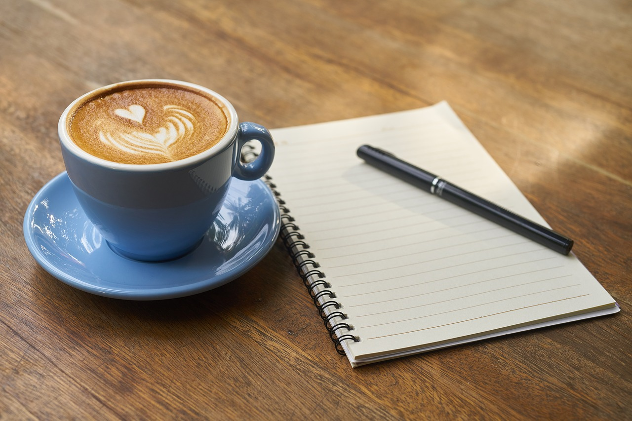 coffee with notebook and pen