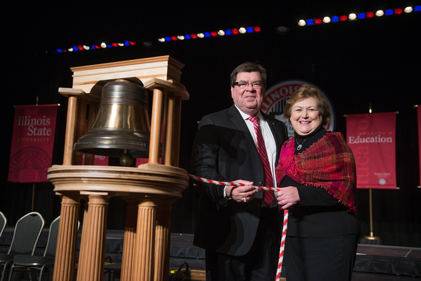 President Larry and First Lady Marlene Dietz prepare to ring the replica of the Founders Bell.