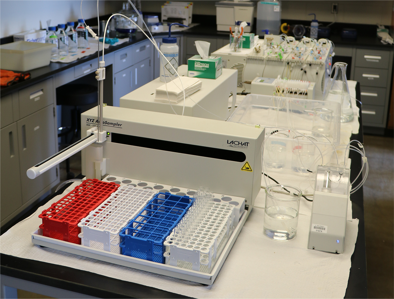 Test tubes, and equipment line a table in the Laboratory for Environmental Analysis
