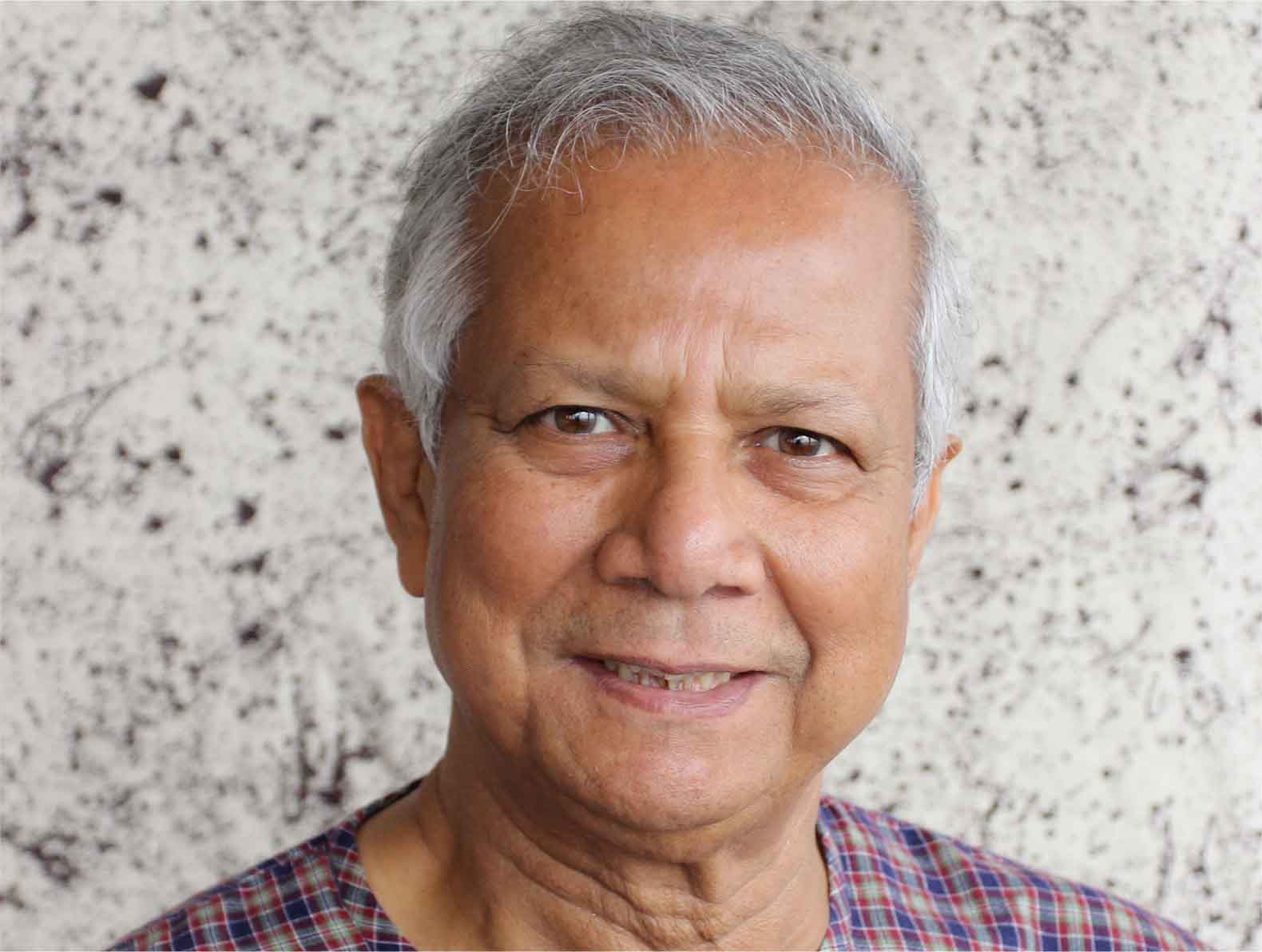 professor Muhammad Yunus smiling for the camera