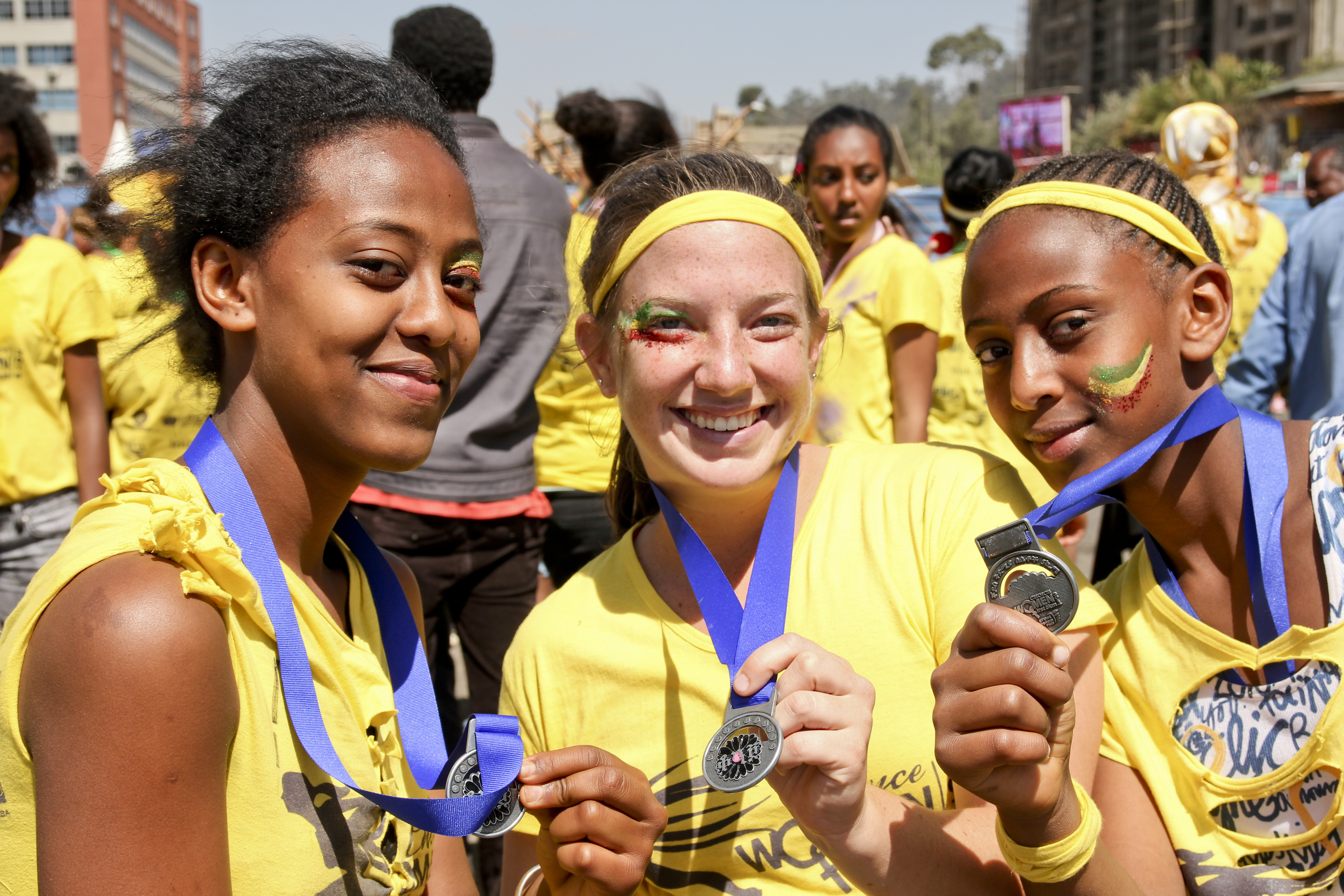 Lauren and two students holding race medals