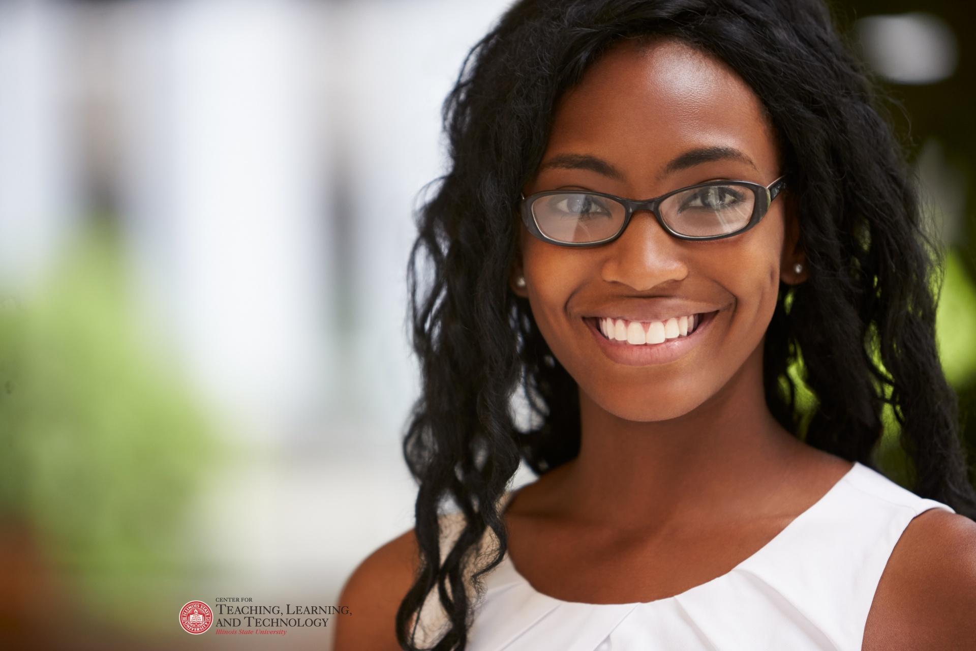 Woman looking at camera, smiling