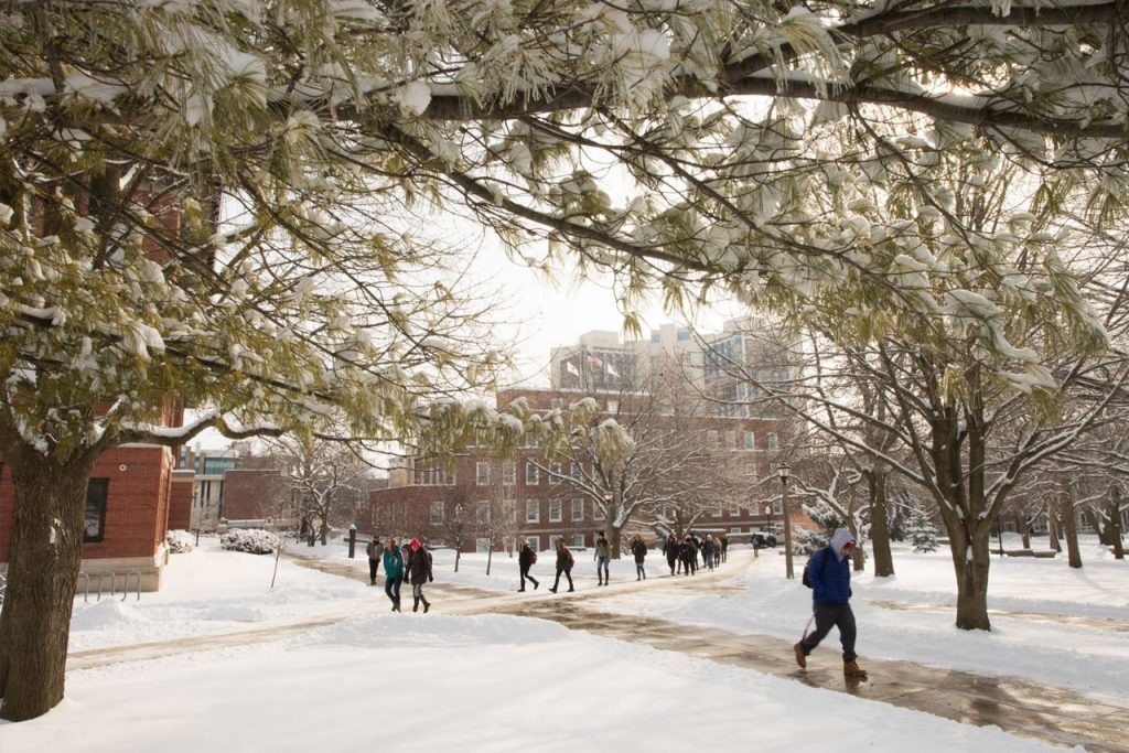Students walking on snowy Quad