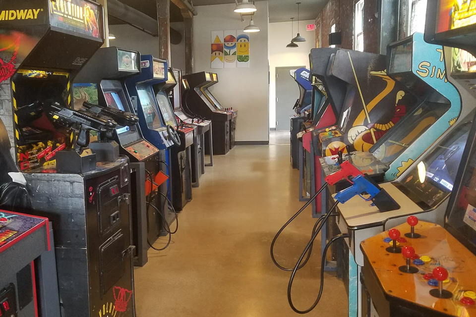 two rows of arcade game machines