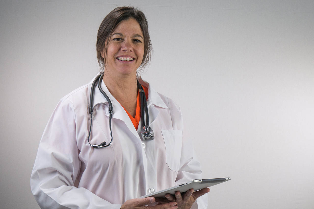 Doctor Nurse with clipboard against a grey background