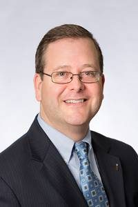 headshot of Dan Wagner wearing glasses