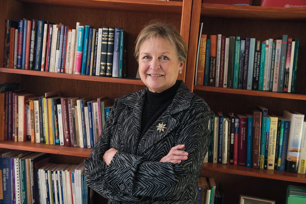 Lynne Haeffele standing in front of bookcase