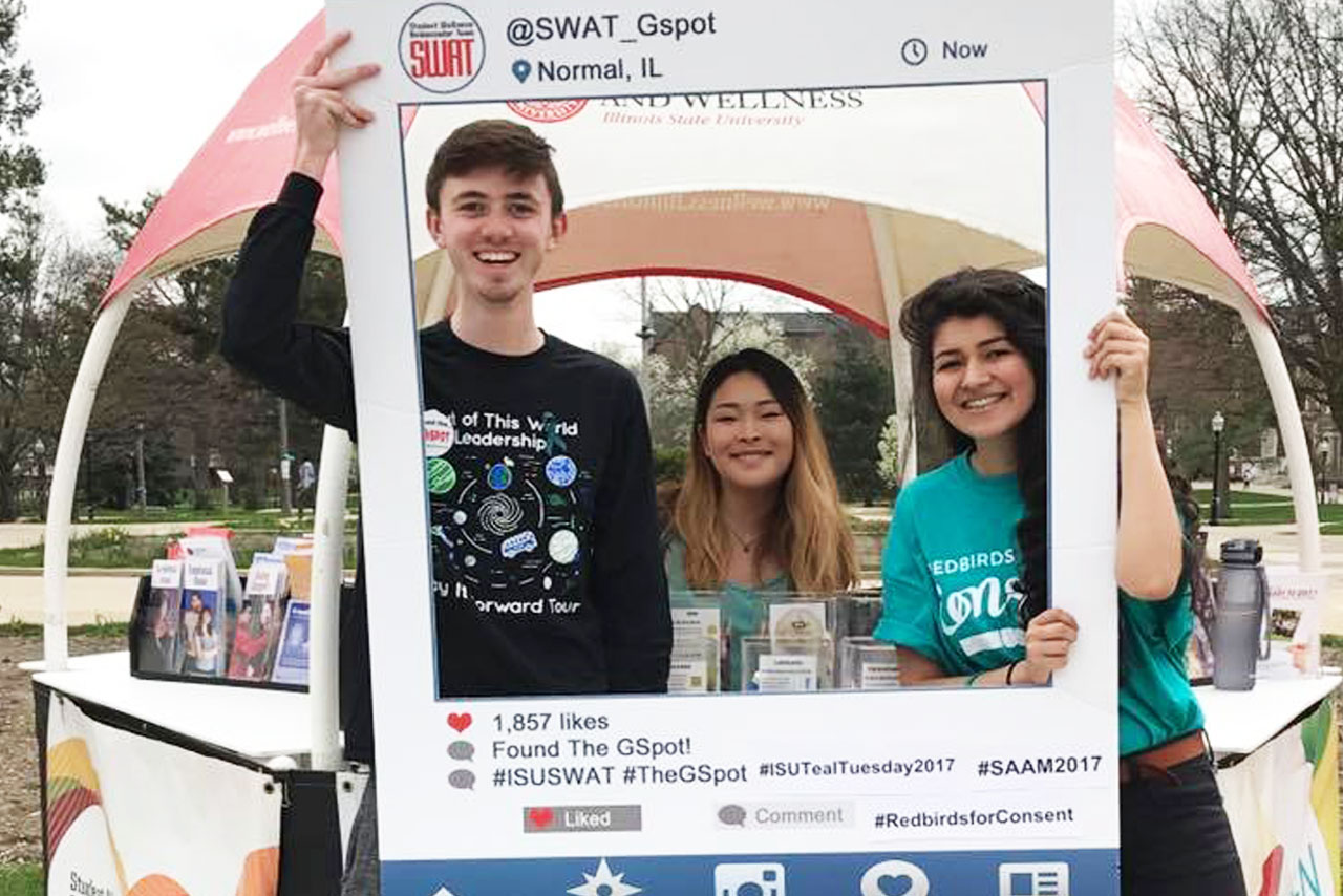 Students posing with Instagram frame from Consent Day 2017