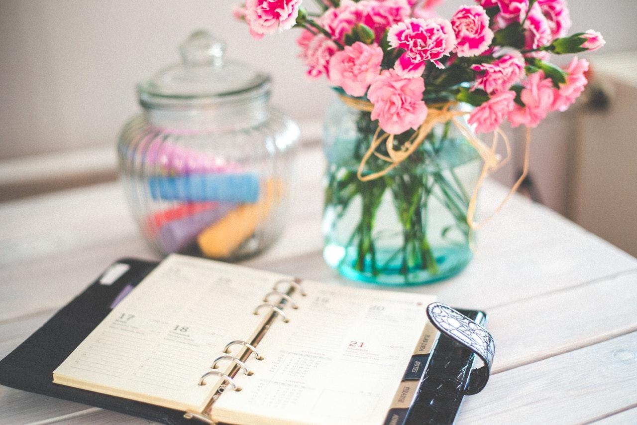 flowers and calendar on desk