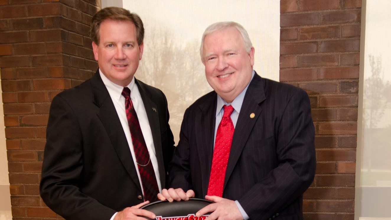 """Steve Adams, the """"voice of the Redbirds,"""" with director of athletics, Larry Lyons"""