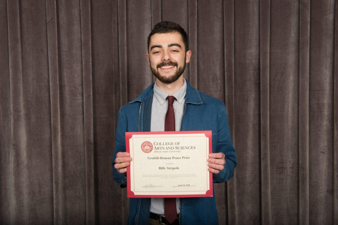 Student holding award