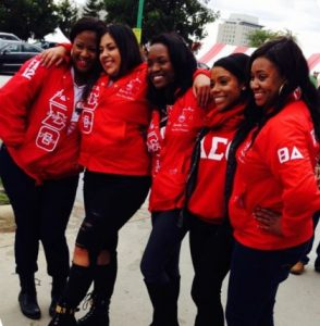 Lauren Bradley and four friends in Redbird gear