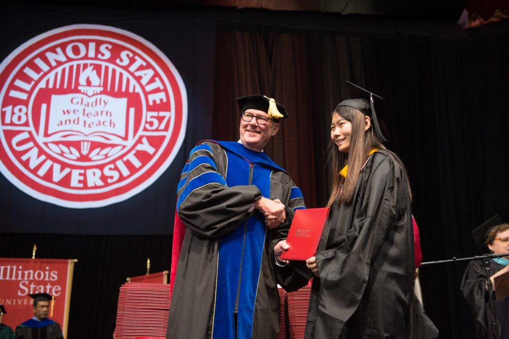 Dean Simpson congratulates a CAS graduate