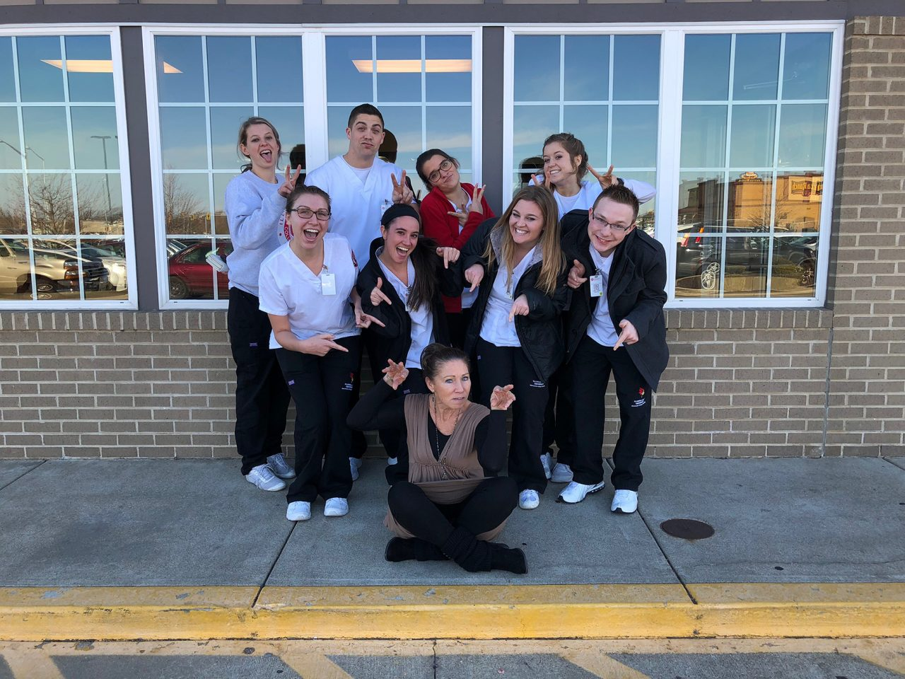 Sierra Rasmus poses with instructor Jamie Penrod and her clinical group.