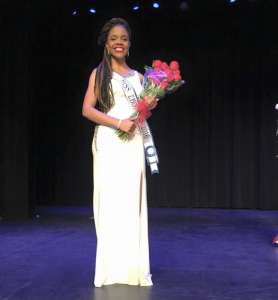 Lauren Chapman on stage at a pageant