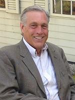 Headshot image of alumnus Robert DuGrenier