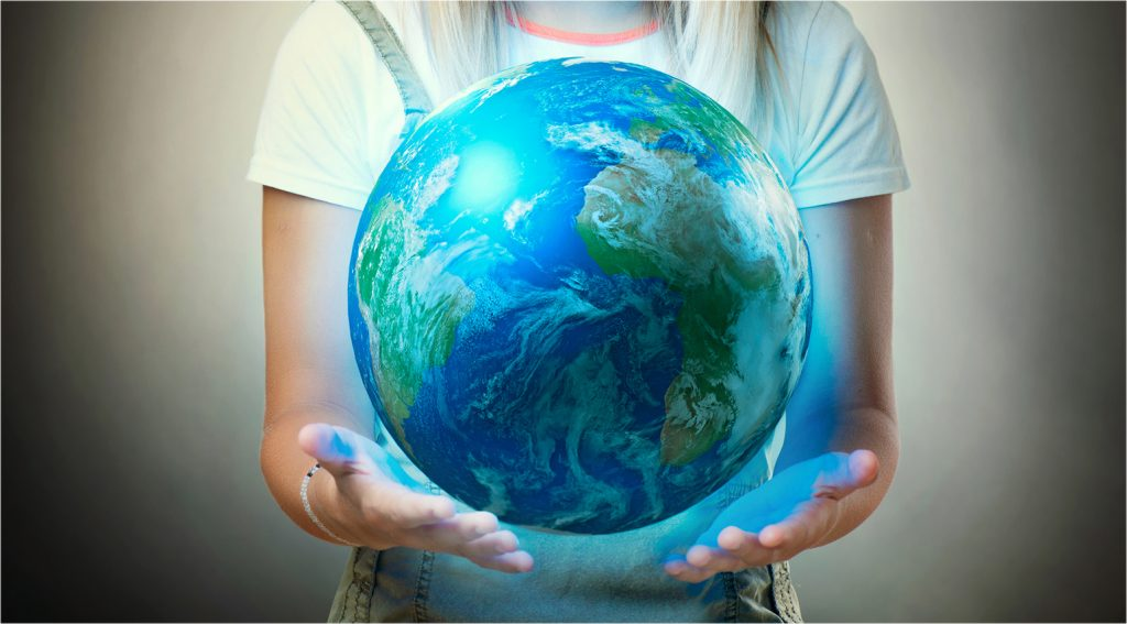 young person holding a globe