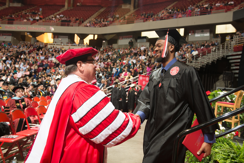 Larry Dietz congratulating a graduate