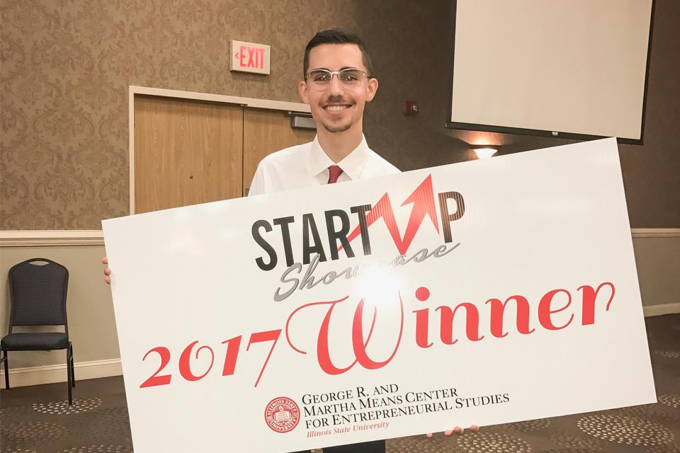 Andrew Frey holding giant winner sign