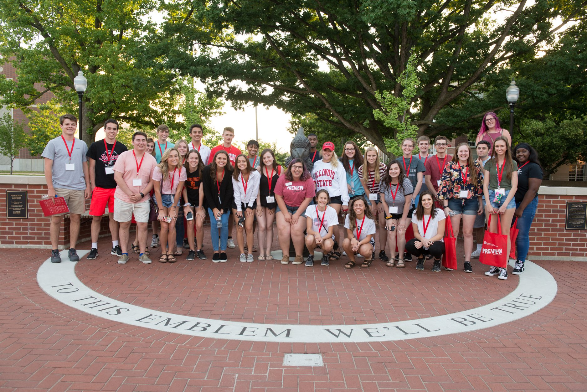 Group of students on campus during Preview standing around Battle Bird in Redbird Plaza.
