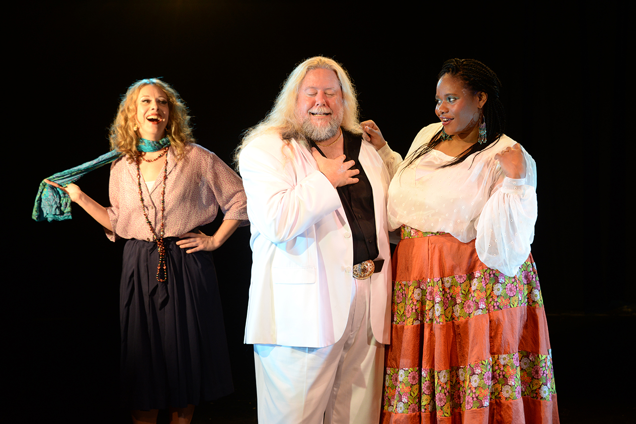 Image of Quetta Carpenter, Steven Young, and Dee Dee Batteast as their characters in The Merry Wives of Windsor.