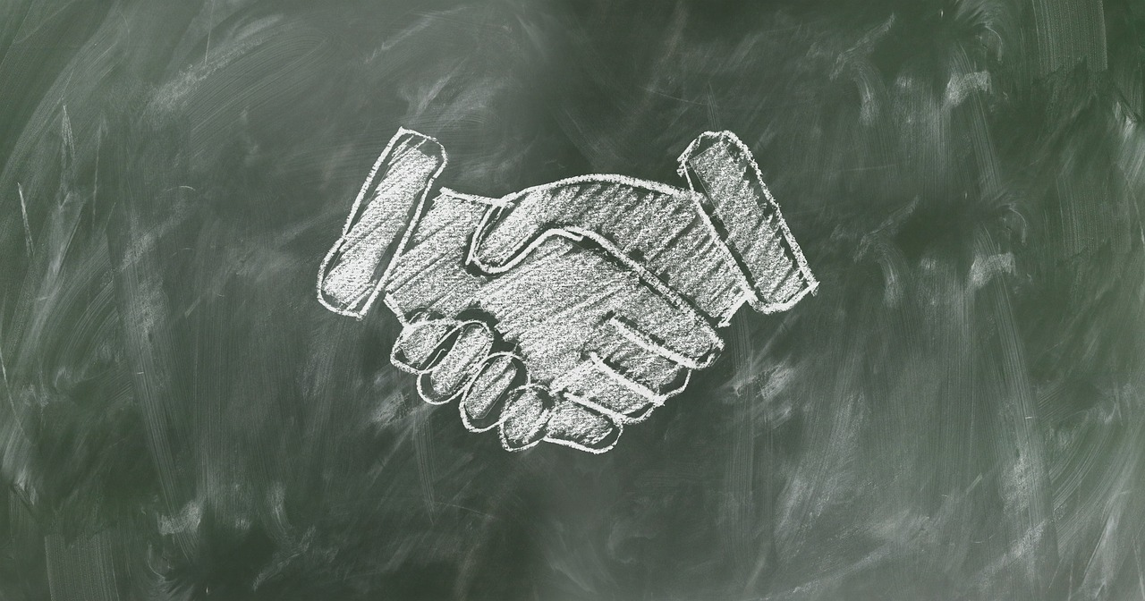 hands shaking on chalk board