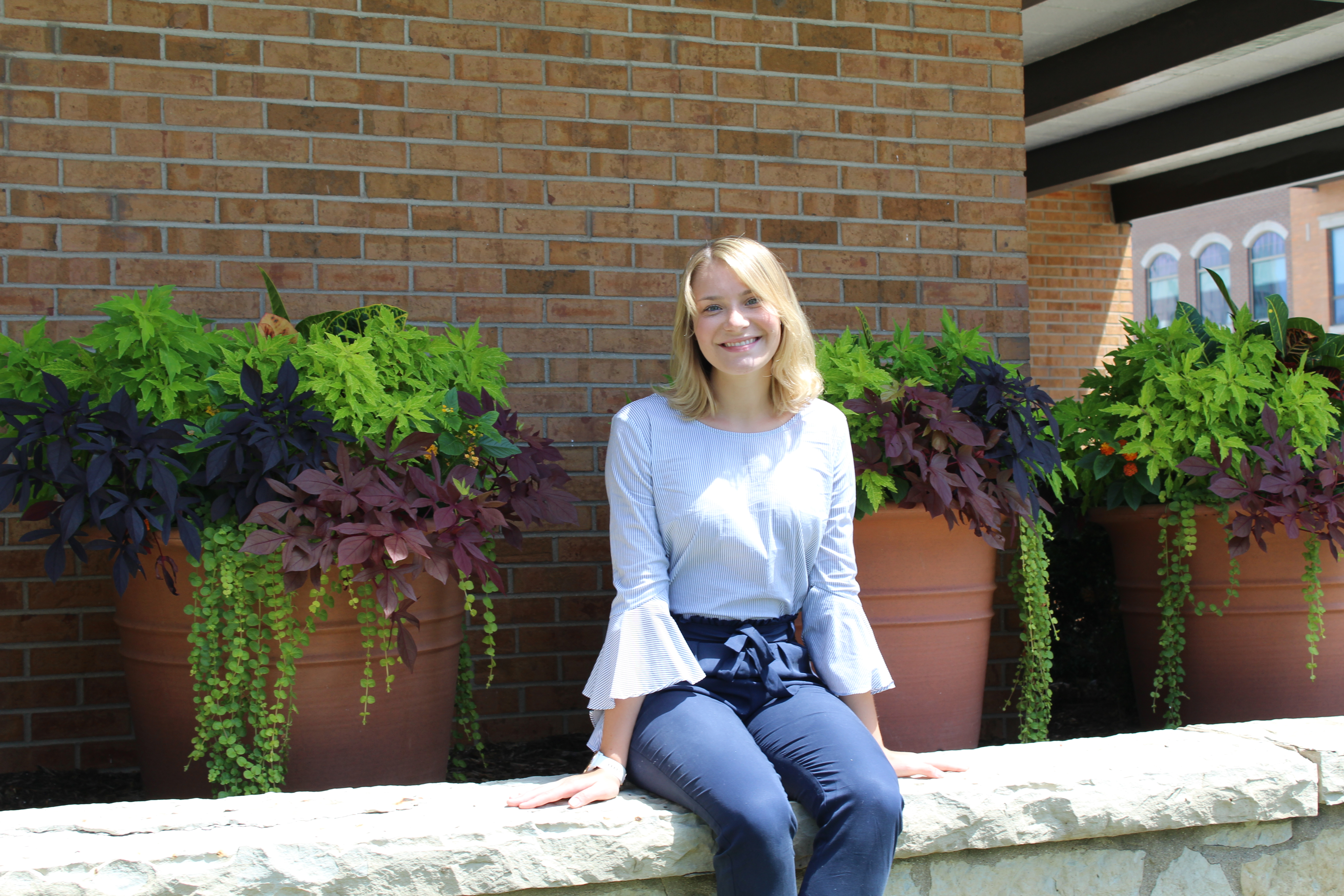 Rachael Wernsman sitting outside the Center for Community Engagement and Service Learning