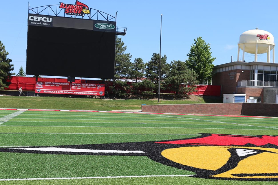football field with big screen in background