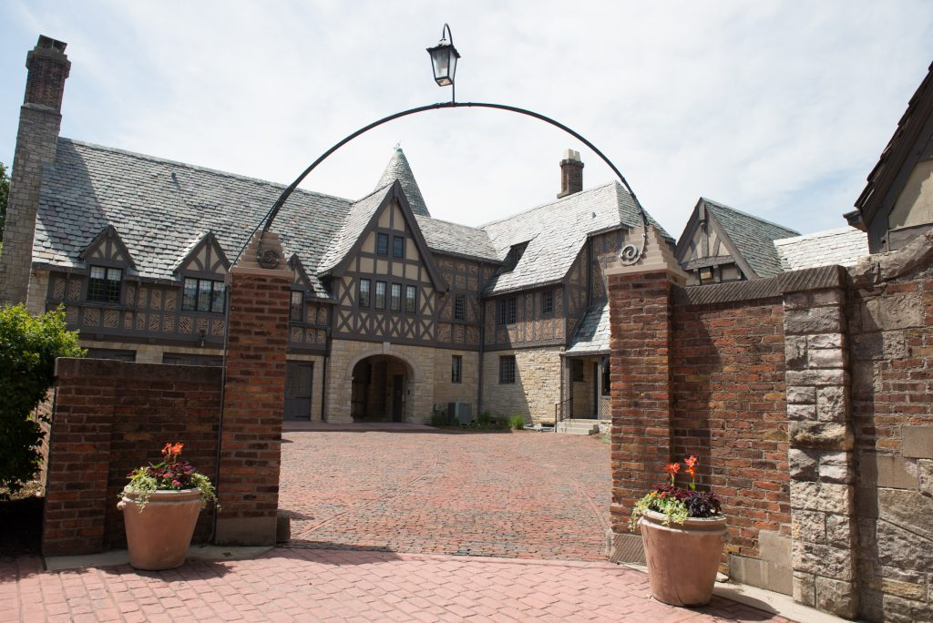 brick-lined path and patios in front of Ewing Manor