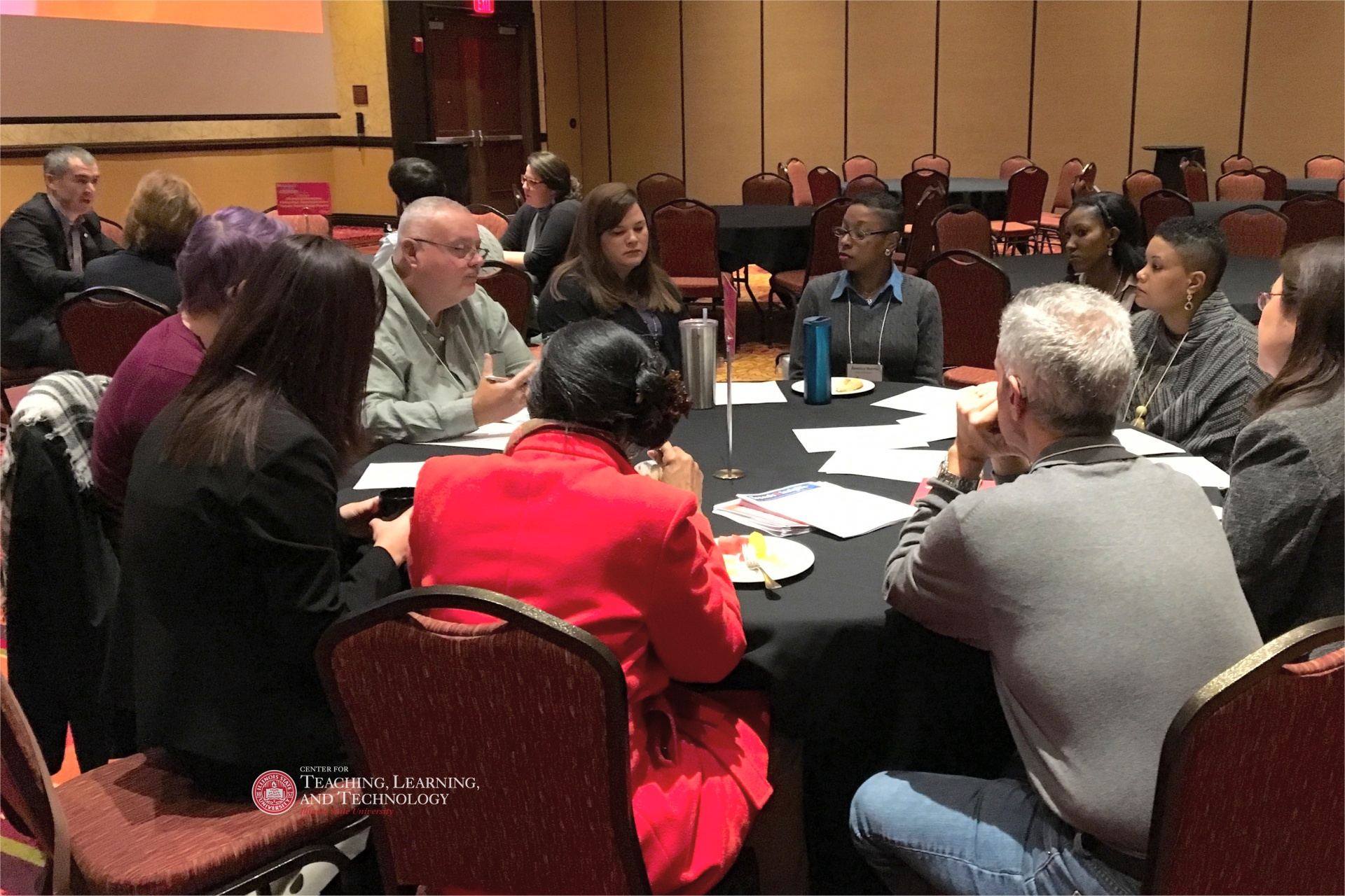 Faculty and staff discussing deep issues at the 2018 University-Wide Teaching & Learning Symposium