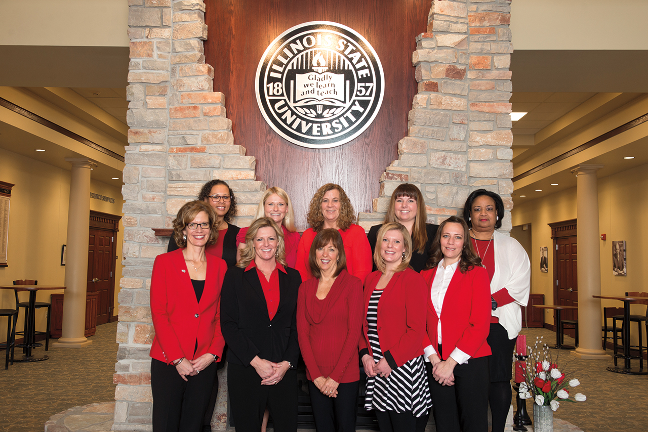 """Kristin """"Kris"""" (Meseth) Harding (front row, far left) began as executive director of the University's Office of Alumni Engagement in the spring following the retirement of Doris (Liefer) Groves '81. Harding leads a staff of nine."""