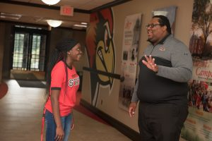 Freshman Makiah Watson with admissions counselor Branden Delk.